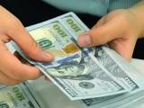Vàng tăng, USD giảm sau quyết định của FED