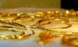 Vàng thế giới vượt 1.300 USD/ounce, trong nước tăng gần 600.000 đồng/lượng