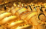 Giá vàng tuần qua lao dốc mạnh do áp lực tăng lãi suất USD