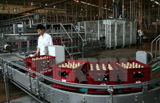 Dây chuyền sản xuất của Habeco tại nhà máy bia Hà Nội-Mê Linh. (Ảnh: Huy Hùng/TTXVN)