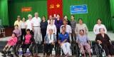 TW Hội Liên hiệp Phụ nữ Việt Nam - Hội Từ thiện Thánh hữu ngày sau tặng xe lăn cho người khuyết tật