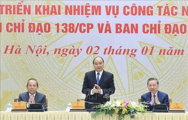 Prime Minister Nguyen Xuan Phuc (middle) at the event (Photo: VNA)