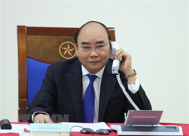 Thủ tướng Nguyễn Xuân Phúc điện đàm với Thủ tướng Australia Scott Morrison về công tác phòng, chống dịch COVID-19. (Ảnh: Thống Nhất/TTXVN)