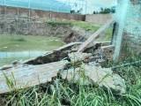 Tường rào sập gây thiệt hại tài sản người khác, phải bồi thường