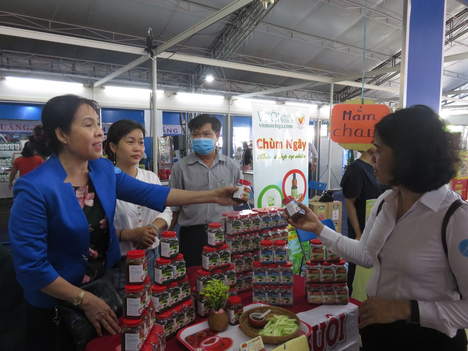 Products are displayed and promoted by the booth of Long An province