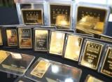 Giá vàng thế giới tuần qua giảm 1% do đồng USD mạnh lên