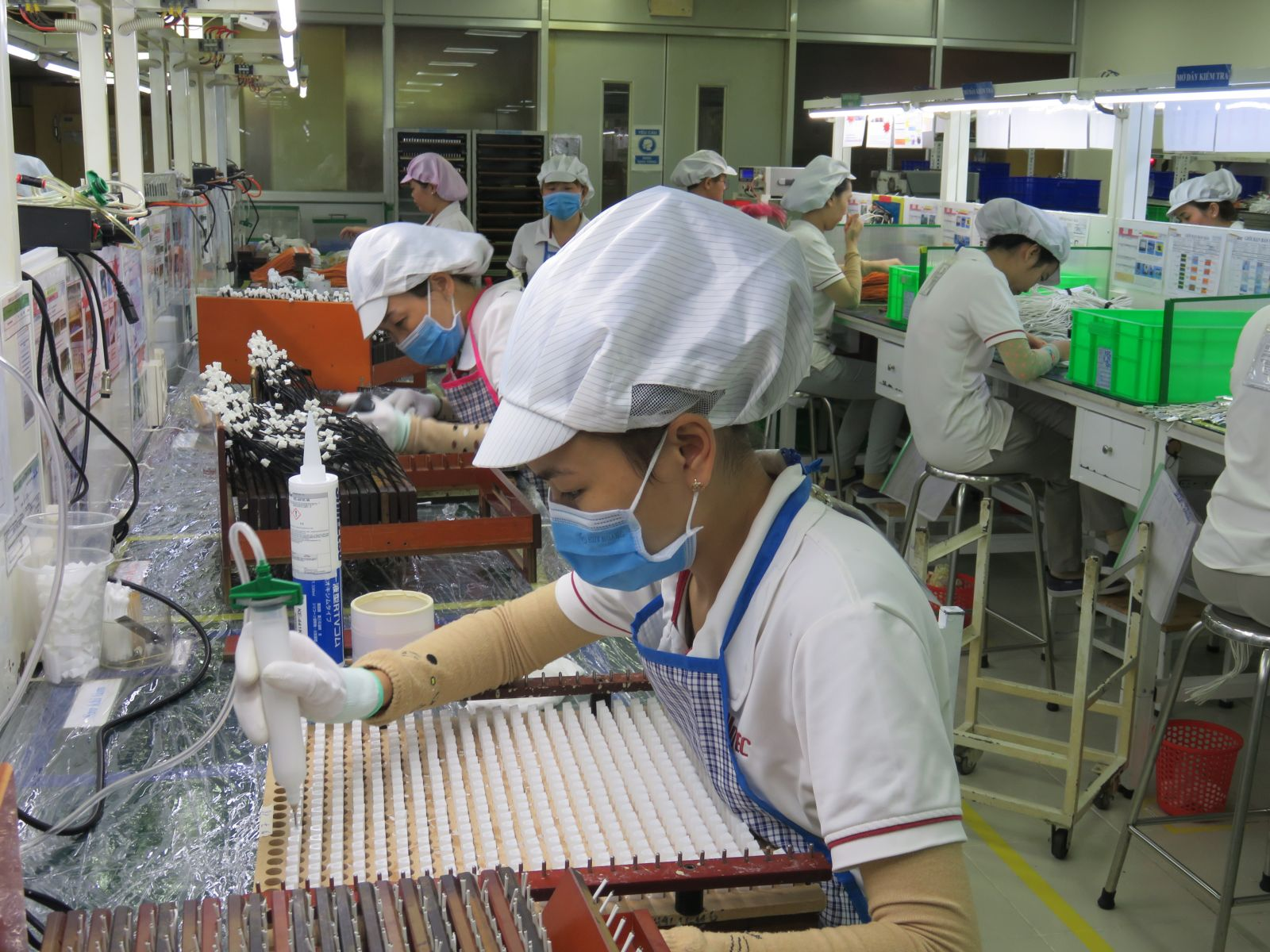Workers produce at the factory Semitec Electronics Company