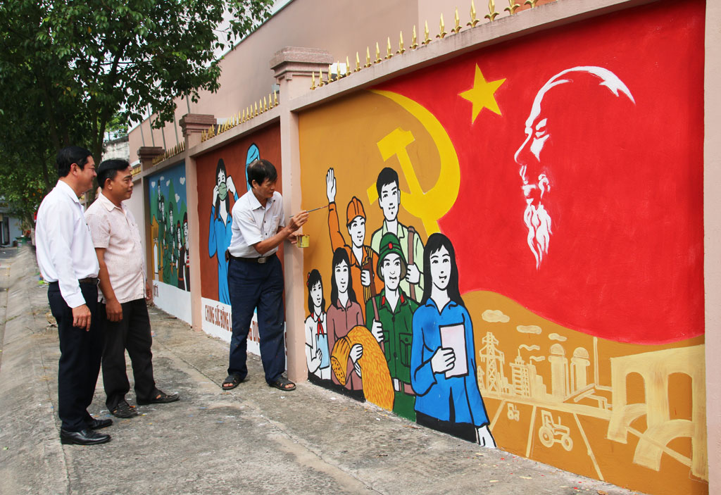 In Tan An City, propaganda photos, banners, posters, and flags are beautifully decorated