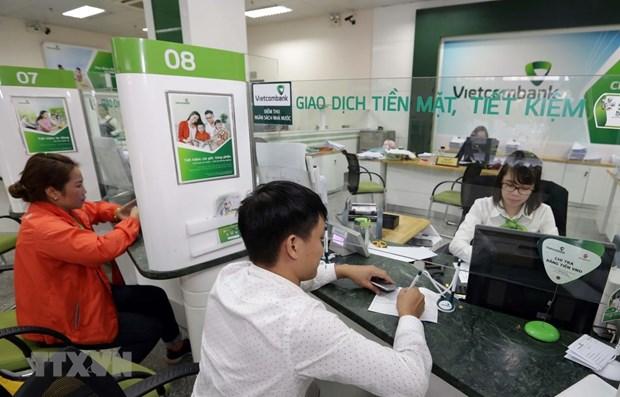 Giao dịch tại Vietcombank (Nguồn TTXVN)